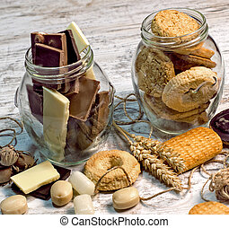 Sweets in jar on rustic table - pleasure for your senses