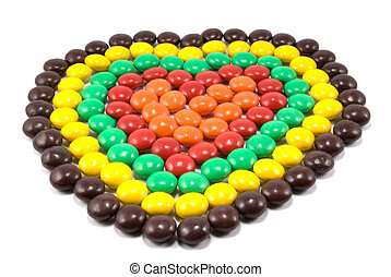 Sweets in multi-coloured chocolate glaze in the form of heart