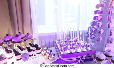 Sweets on buffet table, wedding, the table with sweets, dessert buffet, beautiful alcoholic shots