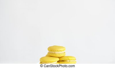 lemon yellow macarons on glass confectionery stand - sweets,...