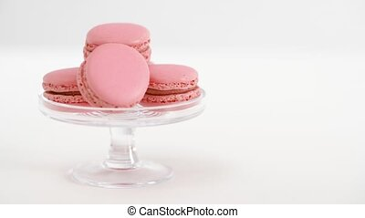 pink macarons on glass confectionery stand - sweets, pastry...