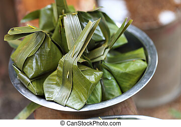 Sweets wrapped in banana leaves.