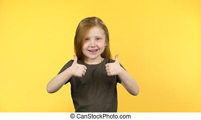 Sweety kid girl gesturing two finger-up signs to show like
