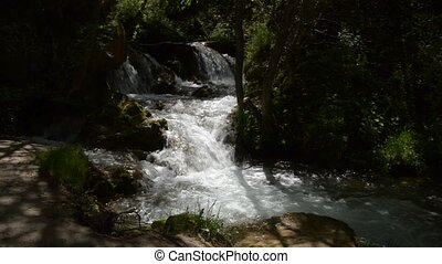 Swift Mountain River with Rapids - Flow of a fast mountain...