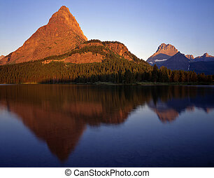 SwiftcurrentLake#3 - Mountains reflecting in Swiftcurrent...