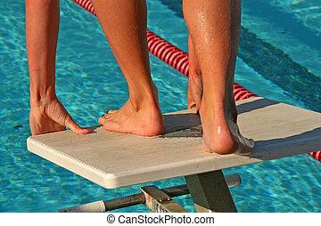 Swim Meet - A high school swim meet and the athletes who...