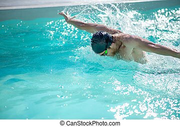 Swimmer during a swim in swimming pool