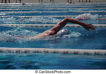 Swimmer - Freestyle swimmer in the outdoor swimming pool