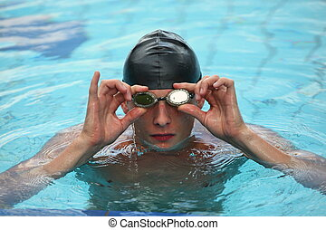 swimmer in  pool, adjusting goggles