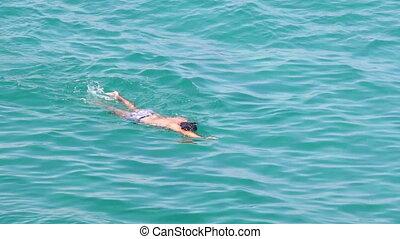 Swimmer in the ocean