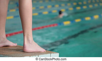 Swimmer Ready to Race in Pool