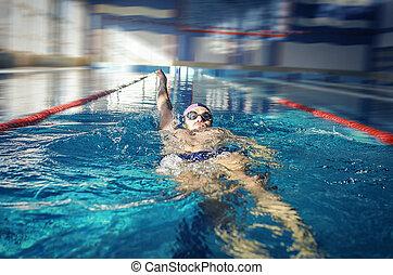 Swimmer swimming backstroke - Man swimmer swimming...