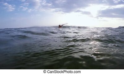 Swimmer swims freestyle - Man swims in sea waves freestyle...