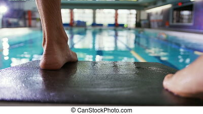 Swimmer training in a swimming pool - Close up of legs and ...