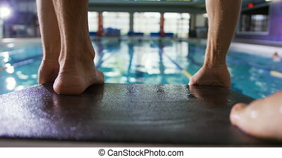 Swimmer training in a swimming pool - Rear view close up of ...