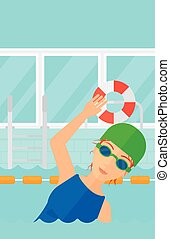Swimmer training in pool. - A woman wearing cap and glasses...