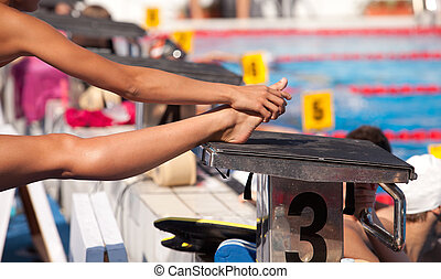 Swimmer warming up and stretching legs