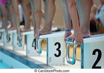 Swimmers on the starting blocks