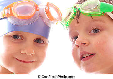 two concentrated kids with goggles on their heads