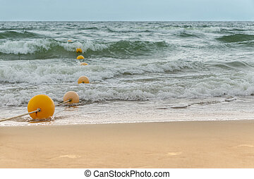 Swimming area for people in sea fenced with buoys
