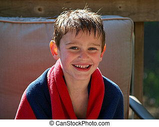 swimming boy wrapped in towel