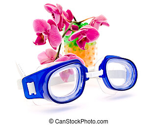 swimming glases - swimming glasses and pink orchid against...