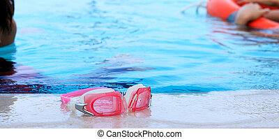 Swimming goggles by the pool.