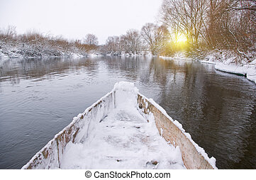 Swimming in a boat on winter river