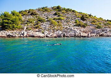 Swimming in the blue sea