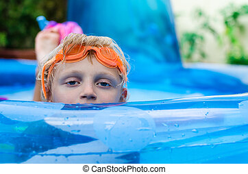 swimming in the inflateble pool
