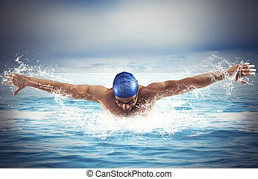 Swimming in the sea - Professional man swimmer swims in open...