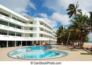 Swimming pool and beach at the popular hotel, Bentota, Sri Lanka