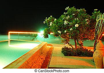 Swimming pool and beach of the luxury hotel in night illumination, Fujairah, UAE