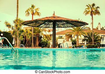 swimming pool at morning . vintage color toned image