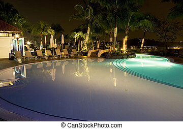 Swimming Pool at Night - Night image of a swimming pool in...