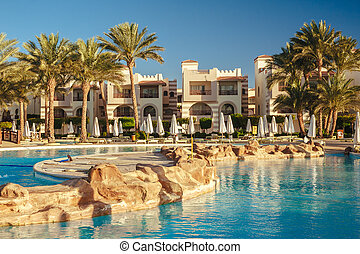 Swimming pool at the beach of luxury hotel, Sharm el Sheikh, Egypt. Luxury hotel in Naama Bay.