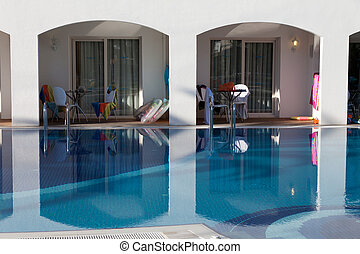 Swimming pool at the modern luxury hotel