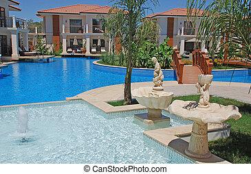 Swimming pool at the summer resort hotel