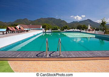 swimming pool besides mountains