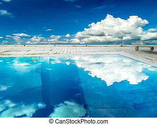 Swimming pool blue sky white cloud reflection