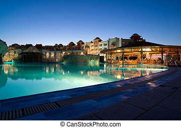Swimming pool in a  hotel resort at evening. Egypt