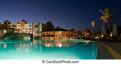 Swimming pool in a  hotel resort at evening