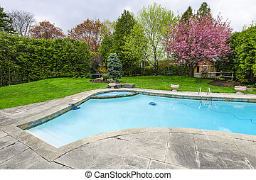 Swimming pool in backyard - Backyard with outdoor inground...