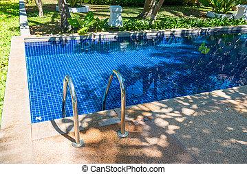 Swimming pool in hotel at tropical resort