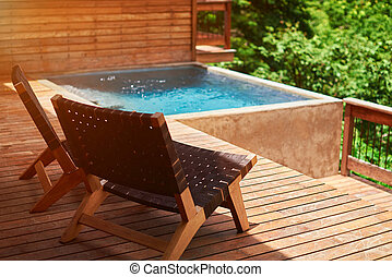 Swimming pool in wooden terrace