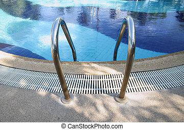 Swimming pool ladder handrail.