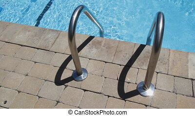 Swimming pool ladder. - Swimming pool ladder beside clean,...
