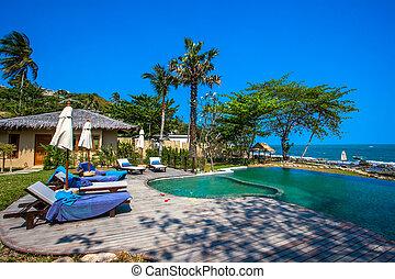Swimming pool near the beach at high class resort in thailand Koh Samui