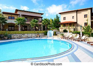 Swimming pool near villa at the luxury hotel, Halkidiki, Greece