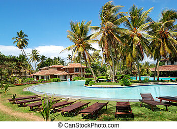 Swimming pool near villas at the popular hotel, Bentota, Sri Lanka